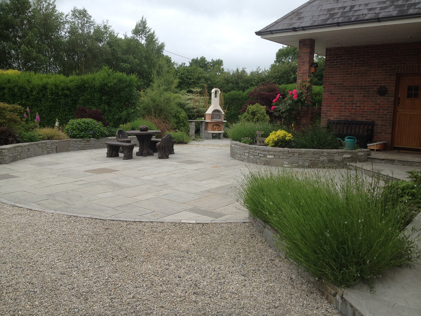large country garden grey sandstone paving with irish limestone raised beds the location was johnstownbridge co kildare this project was completed in