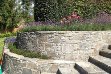 Large retaining wall with steps