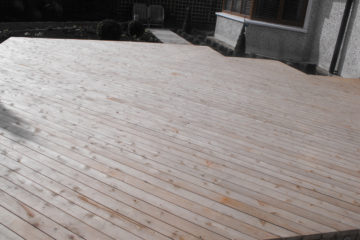 Cedar Decking and Sandstone Paving